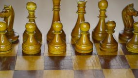 Vintage wooden chess. Set on board, sliding camera movement stock video