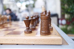 Vintage wooden chess set at outdoor table Royalty Free Stock Image