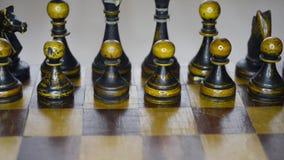 Vintage wooden chess set up. Vintage wooden black chess set on board, sliding camera movement stock video