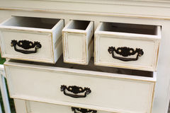 Vintage wooden chest of drawers with black metal handles open Stock Photos