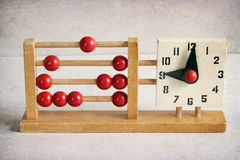 Vintage wooden children's clock and abacus Stock Photo