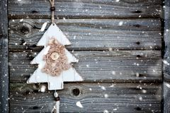 vintage wooden christmas decoration hanging - rustic holiday background stock image