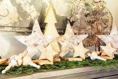 Vintage wooden Christmas trees and stars display stock photography