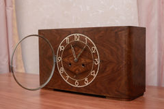 Vintage wooden clock with the lid open. Vintage old table clock in wooden case with glass lid Royalty Free Stock Photo