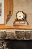 Vintage wooden clock on the mantelpiece Royalty Free Stock Image