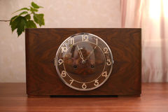 Vintage wooden clock. Vintage old table clock in wooden case with glass lid Stock Photo