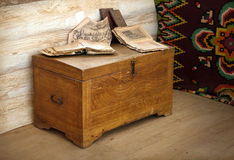 Vintage wooden coffer with books