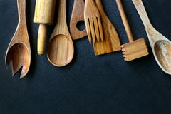 Vintage Wooden Cooking Utensils Framing Black Slate Background Royalty Free Stock Images
