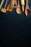 Vintage Wooden Cooking Utensils Framing Black Slate Background Royalty Free Stock Image