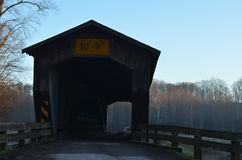 Vintage wooden covered bridge on rural road Royalty Free Stock Photo