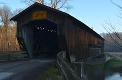 Vintage wooden covered bridge on rural road Stock Photos