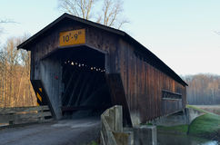Vintage wooden covered bridge on rural road Stock Images