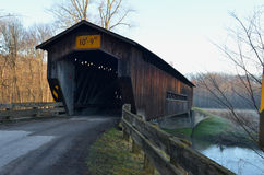 Vintage wooden covered bridge on rural road Stock Photo
