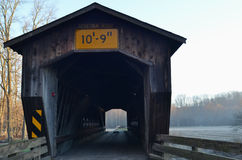 Vintage wooden covered bridge on rural road Royalty Free Stock Photos