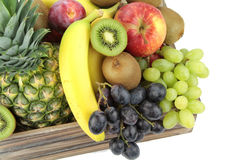 Vintage wooden crate full of colorful fresh fruits. Royalty Free Stock Images