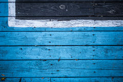 Vintage wooden dark wood, half painted in blue. Royalty Free Stock Photo