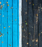 Vintage wooden dark wood, half painted in blue. Royalty Free Stock Photography