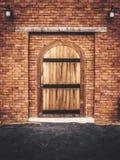 Vintage wooden door and brick wall. Classic vintage wooden door and brick wall Stock Photos