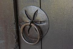 Vintage wooden door with forged handle and knocker stock image
