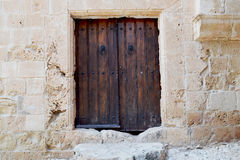 Vintage wooden door - a fragment of an ancient monastery. Cyprus. Ayia Napa Royalty Free Stock Photos