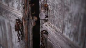 Old brown door. Door of old barn with iron on it