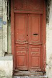 Vintage wooden door painted red with letterbox hole. Vertical Stock Image