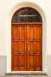 Vintage wooden door in wall arch Royalty Free Stock Image