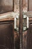 Vintage wooden doors with brass door knobs. Vintage textured wooden doors with brass door knobs Royalty Free Stock Image