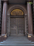 Vintage wooden entrance doors to city building Stock Images