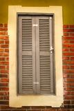 Vintage wooden European window. Vintage window with gray painted blinds stock images