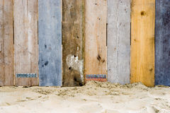 A vintage wooden fence. A fence on a beach made from wood which used to be part of a scaffold Stock Photos