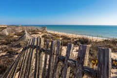 Vintage wooden fence on the background of the sea. Royalty Free Stock Photo