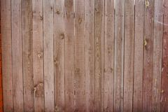 Vintage wooden fence with traces of old paint, scuffs and scratches. Photo close-up Royalty Free Stock Images
