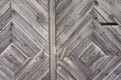 Vintage wooden fence with traces of old paint, scuffs and scratches. Photo close-up Royalty Free Stock Image