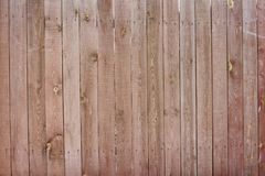 Vintage wooden fence with traces of old paint, scuffs and scratches. Photo close-up Stock Photography