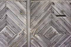 Vintage wooden fence with traces of old paint, scuffs and scratches. Photo close-up Royalty Free Stock Photography