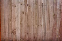 Vintage wooden fence with traces of old paint, scuffs and scratches. Photo close-up Stock Photos