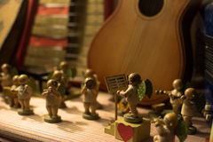 Vintage wooden figures playing musical instruments angels Stock Photos