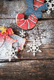 Vintage Wooden Fir Tree Toys Candy Cane, Bell and Snowflakes on Rustic Background Royalty Free Stock Image