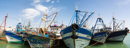 Vintage wooden fishing boats in the harbor of Essaouira Stock Photos