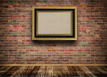 Vintage wooden frame on bricks wall. Royalty Free Stock Photography