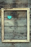 Vintage wooden frame with heart on a grunge background Royalty Free Stock Photography