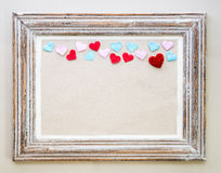 Vintage wooden frame with hearts for Valentine's day background. Royalty Free Stock Photo