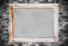 Vintage wooden frame on old brick wall background. Stock Photo