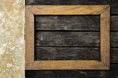 Vintage wooden frame on old dark wooden floor royalty free stock photo