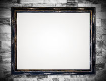 Vintage wooden frame on old marble wall background. Royalty Free Stock Photo