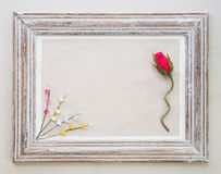 Vintage wooden frame with rose and flower for Valentine's day ba Royalty Free Stock Photography