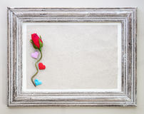 Vintage wooden frame with rose and heart for Valentine's day bac Stock Images