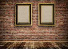 Vintage wooden frames on bricks wall. Stock Images