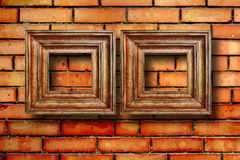 Vintage wooden frames for pictures on brick wall Royalty Free Stock Photography